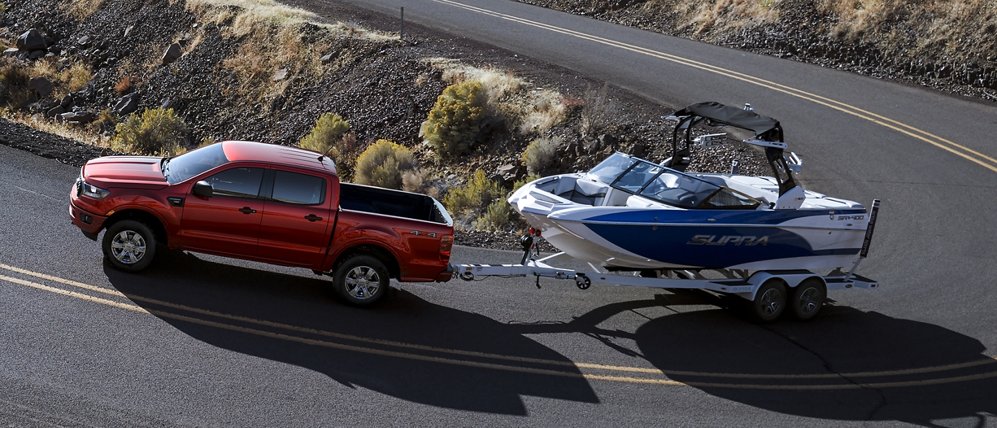 2019 Ford Ranger towing a boat on a sharp curve