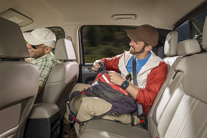 Man sitting in rear seat of 2019 Ford Ranger SuperCrew