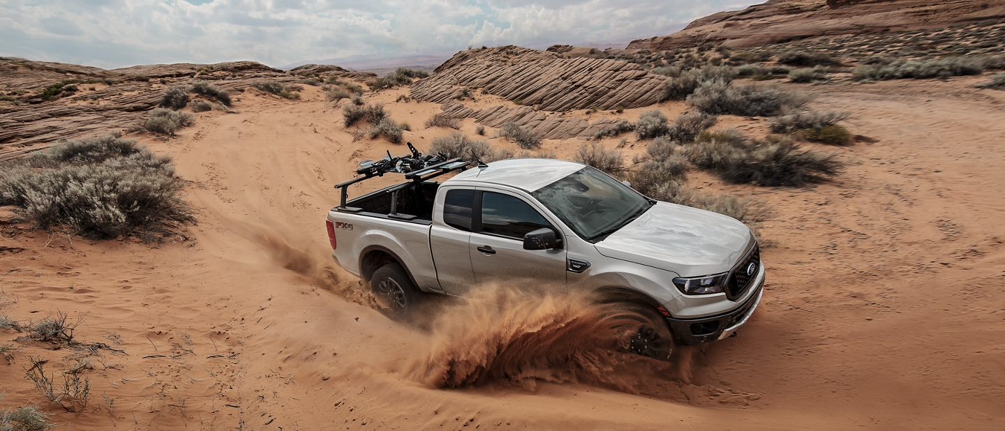2019 Ford Ranger taking a sharp curve on sand dune