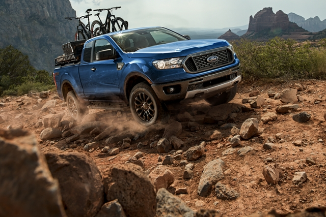 2019 Ford Ranger on rocky terrain with trail bikes on pickup bed rack