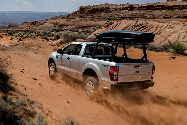 2019 Ford Ranger with F X 4 Off Road Package going up desert hill with optional bed mounted rack accessory