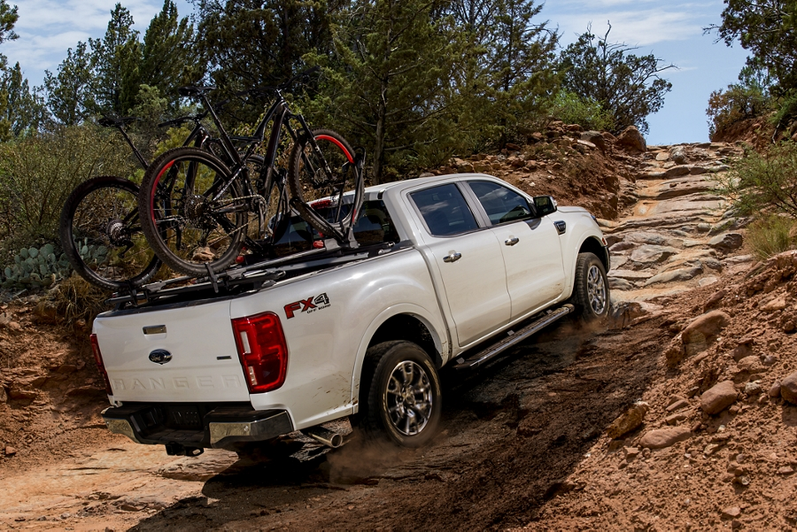 2019 Ford Ranger with F X 4 Off Road Package going uphill with trail bikes on bed rack