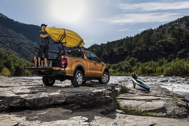 2019 Ford Ranger at river bank with men unloading kayaks