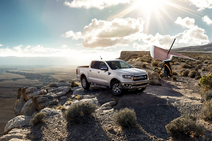 2019 Ford Ranger on rocky desert terrain with hang glider