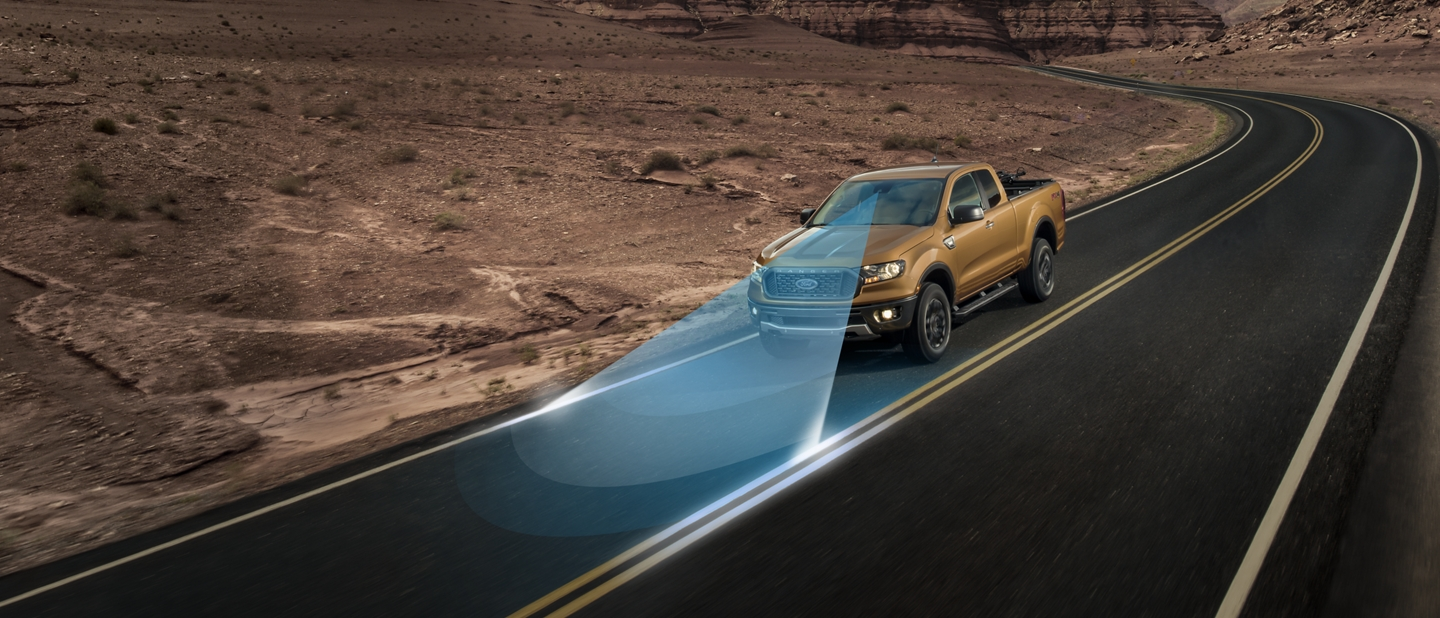 2019 Ford Ranger cruising on paved road through desert area