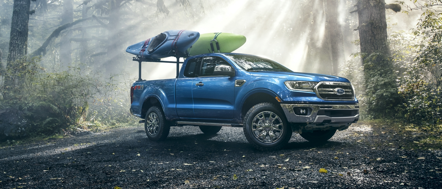 2020 Ford Ranger in Lighting Blue with the optional bed rack holding canoes