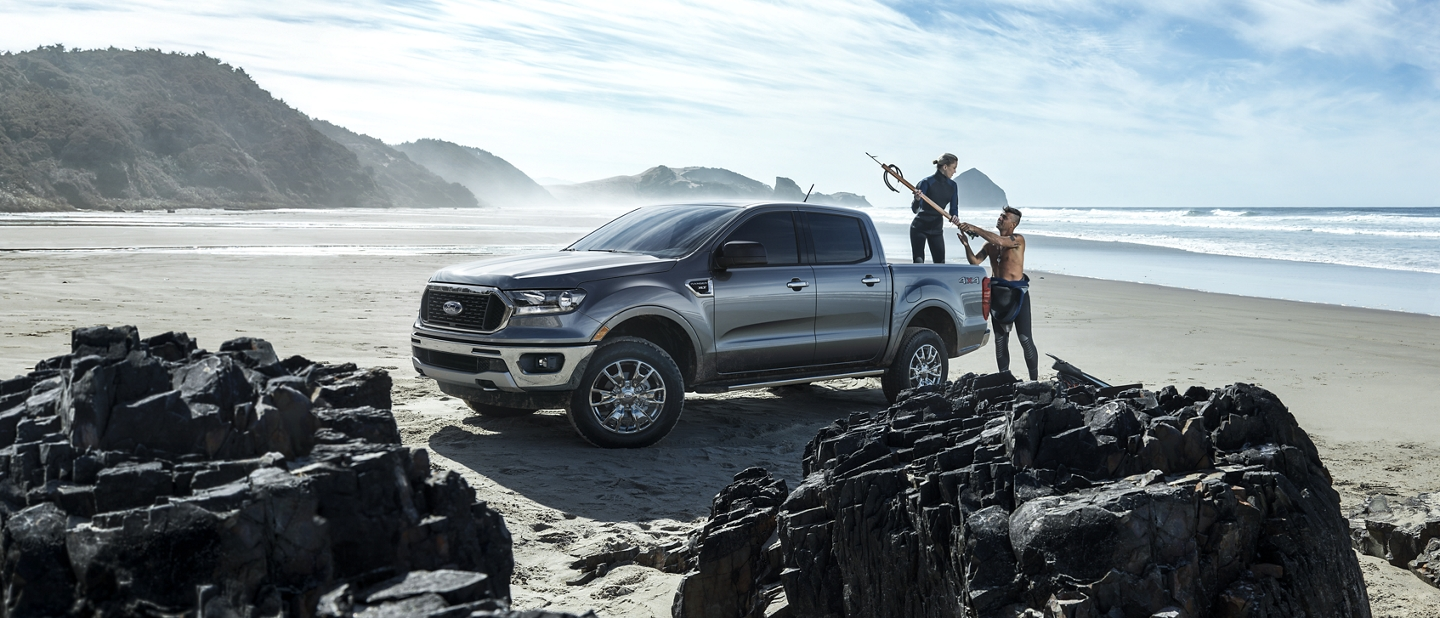 2020 Ford Ranger in Magnetic by the shoreline on a rocky beach