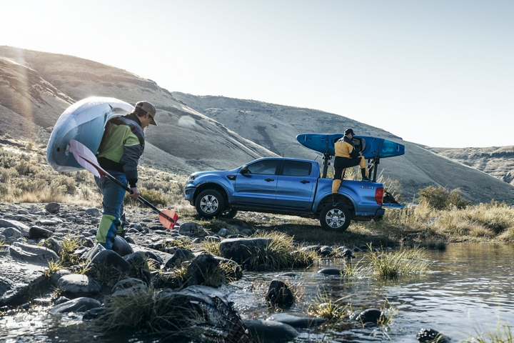 2020 Ford Ranger in Lightning Blue with kayakers at stream with optional bed mounted rack accessory