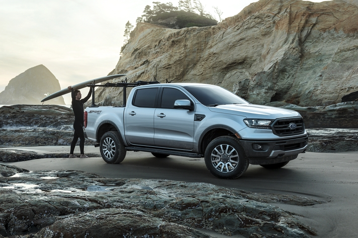 2020 Ford Ranger at oceanfront with surfer shown with optional bed mounted rack accessory