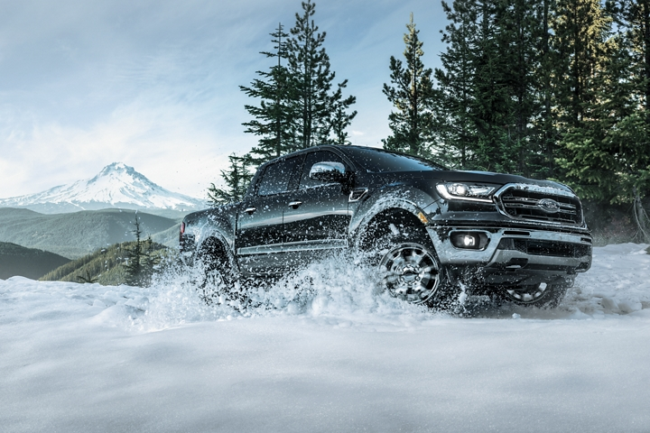 2020 Ford Ranger F x 4 LARIAT Super Crew being driven off road in the snowy mountains