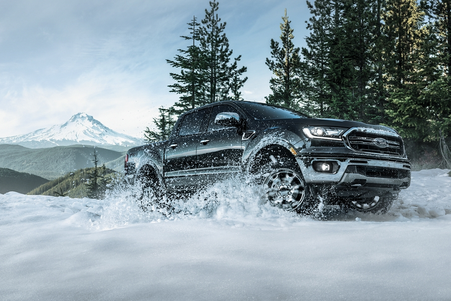 2020 Ford Ranger F X 4 LARIAT being driven in the mountains through the snow