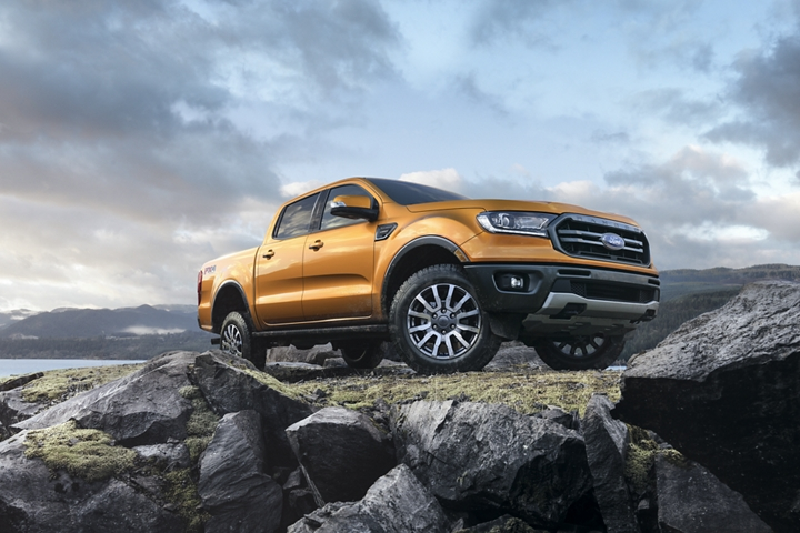 2020 Ford Ranger in Saber on rocky terrain with a body of water in background