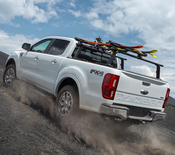 2020 Ford Ranger LARIAT F X 4 in White Platinum Tri coat shown kicking up dust