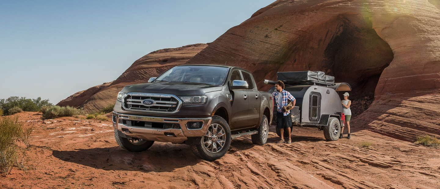 2020 Ford Ranger in Magnetic with camper trailer on rocky desert terrain