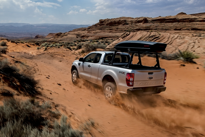 2020 Ford Ranger with S T X Package going up desert hill with optional bed mounted rack accessory