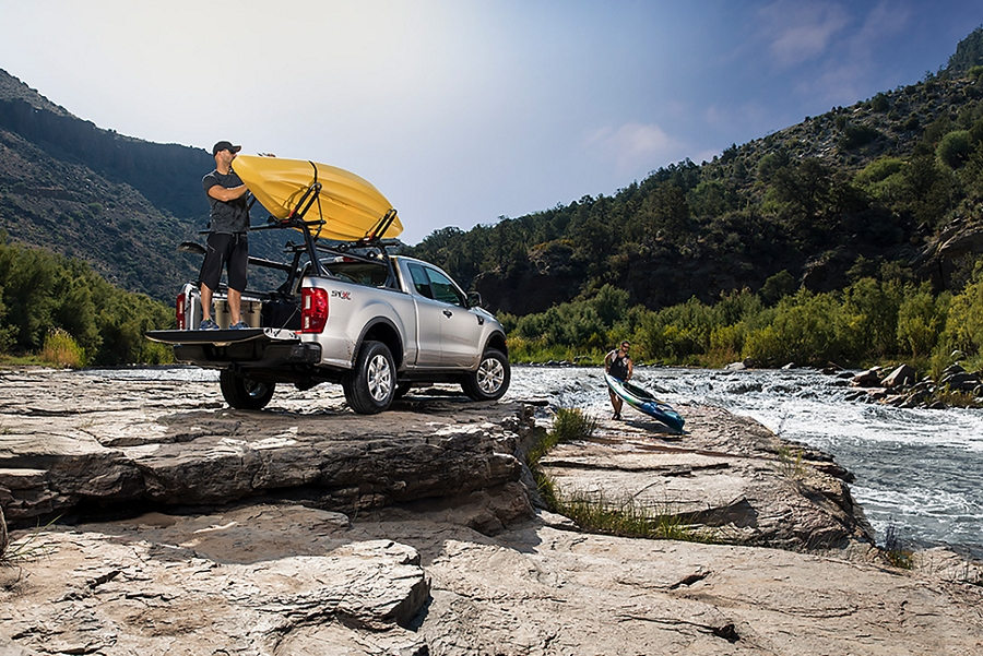 2020 Ford Ranger in Iconic Silver at riverbank with men unloading kayaks