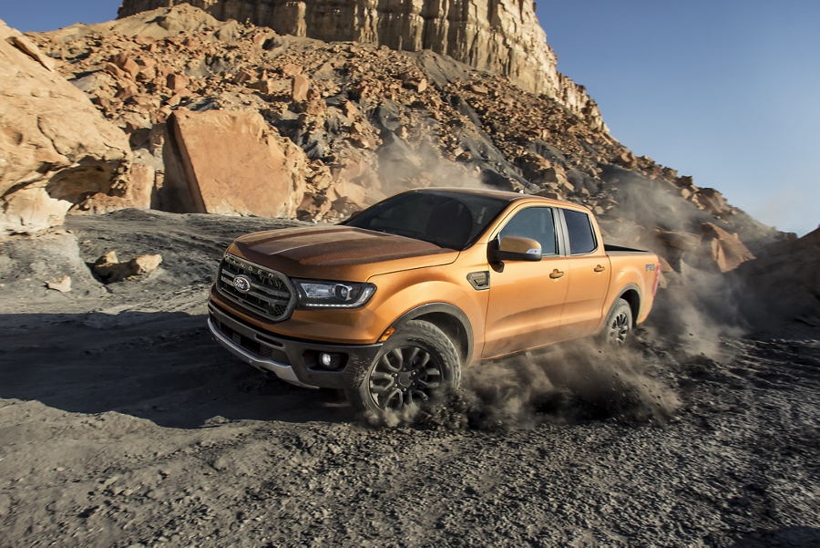2020 Ford Ranger in Saber being driven uphill on heavy dirt terrain
