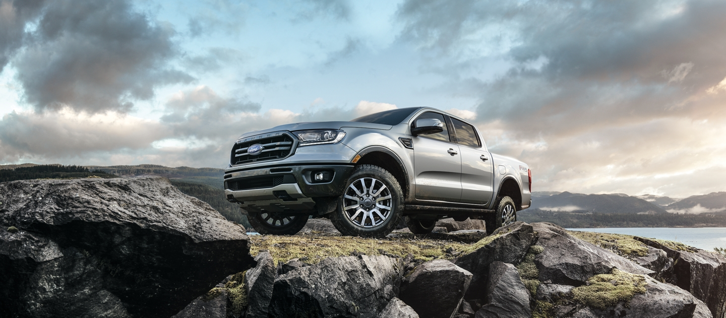 2020 Ford Ranger in Iconic Silver on a rocky cliff in the mountains