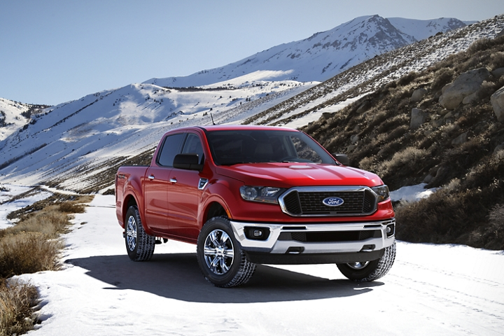 2020 Ford Ranger X L T in Race Red with Chrome Appearance Package driving through snowy mountains