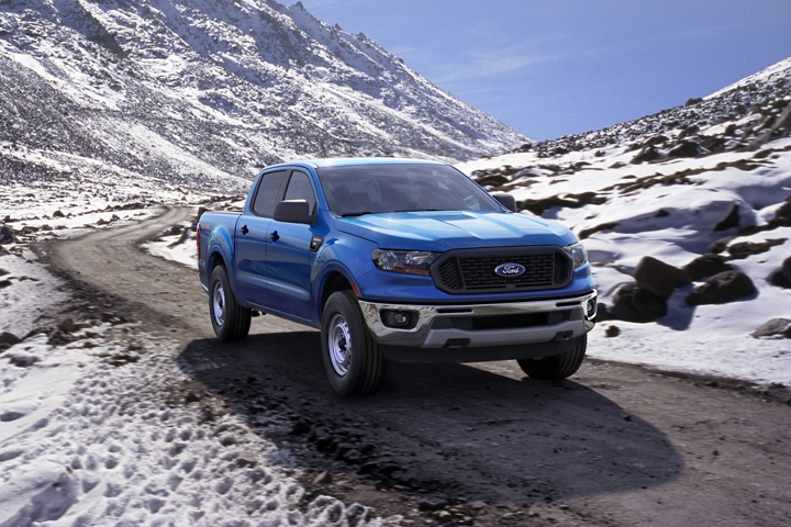 2020 Ford Ranger X L in Blue Lightning with Chrome Appearance Package driving through snowy mountains