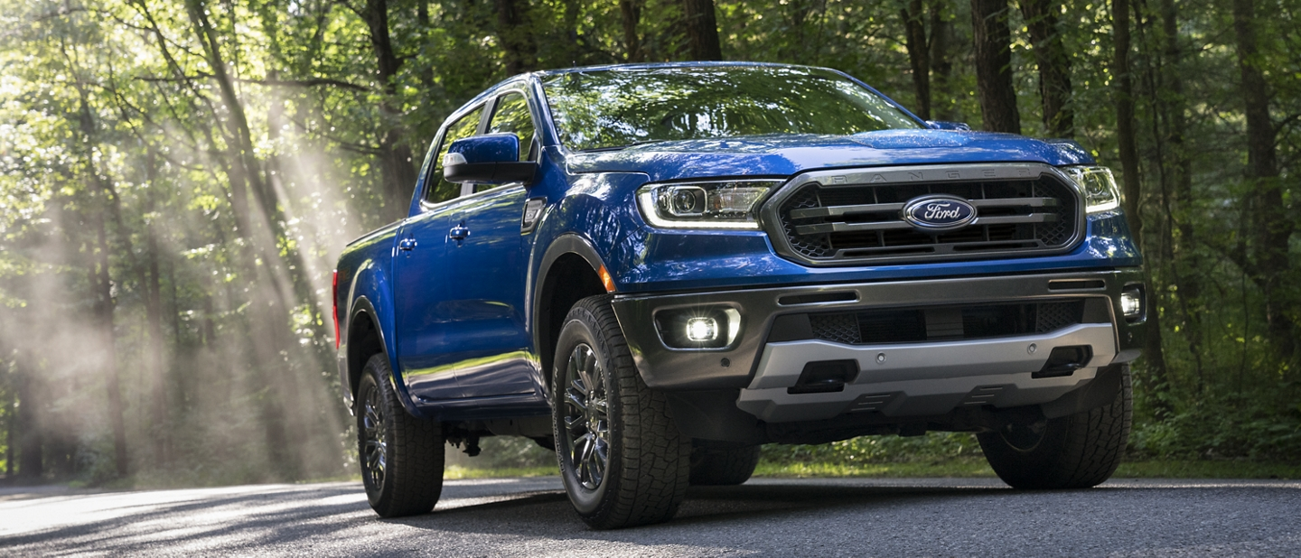 Lightning Blue 2020 Ford Ranger being driven on a road through the woods