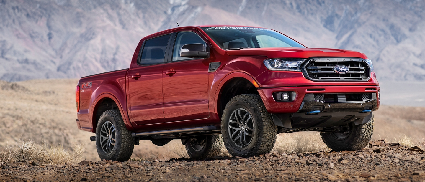 2020 Ford Ranger with Ford Performance Level 2 Package in Race Red parked on dirt with mountains in the background