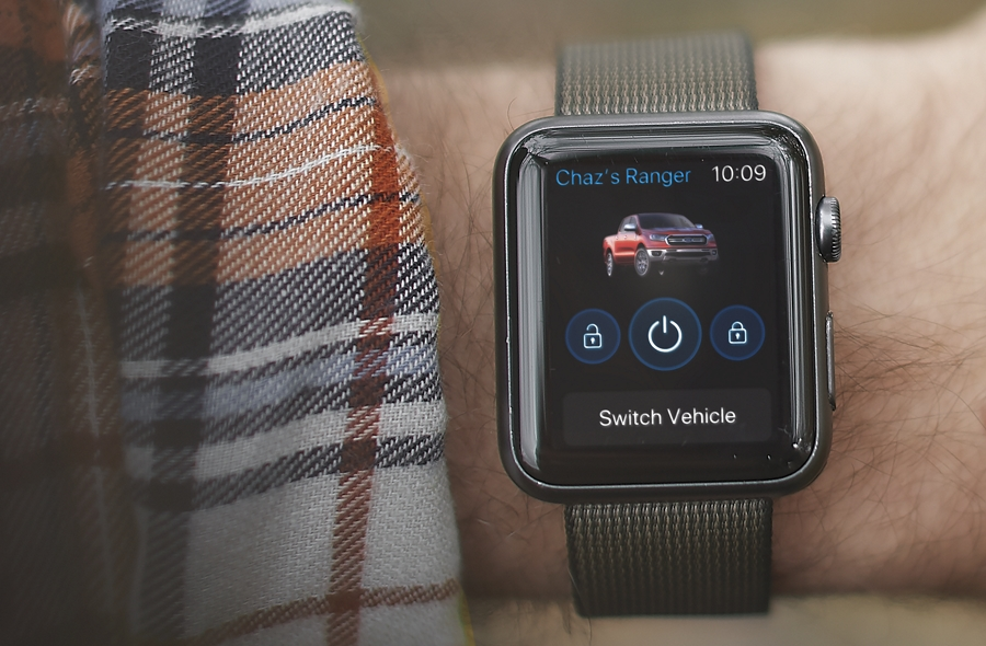 Close view of the apple watch screen with the unlock vehicle screen selected