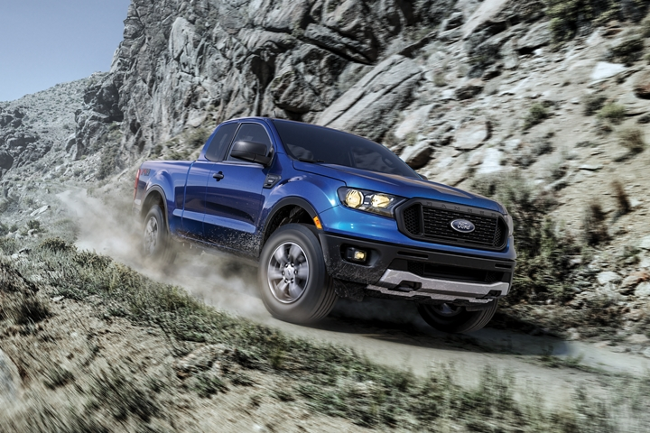 2020 Ford Ranger in Lightning Blue traveling down unpaved mountainside road