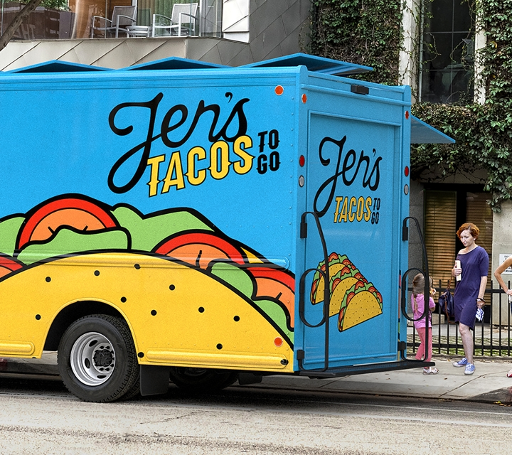 A taco truck parked in front of an apartment complex