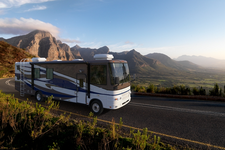 Class A Motorhome on a 2020 F 53 stripped chassis being driven through the mountains