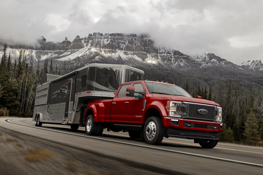 2020 Ford Super Duty with fifth wheel hitch towing a large trailer