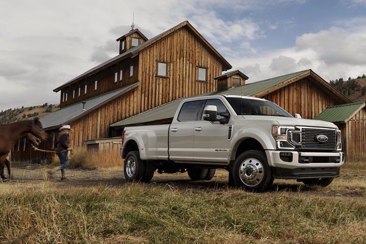 2020 Ford Super Duty F 4 50 Limited Crew Cab in Star White Metallic on a farm with farmer and horse in the background