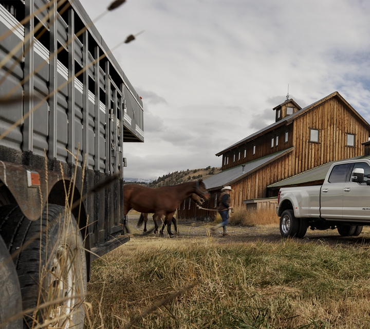 A rancher leads a horse by a 2020 Super Duty