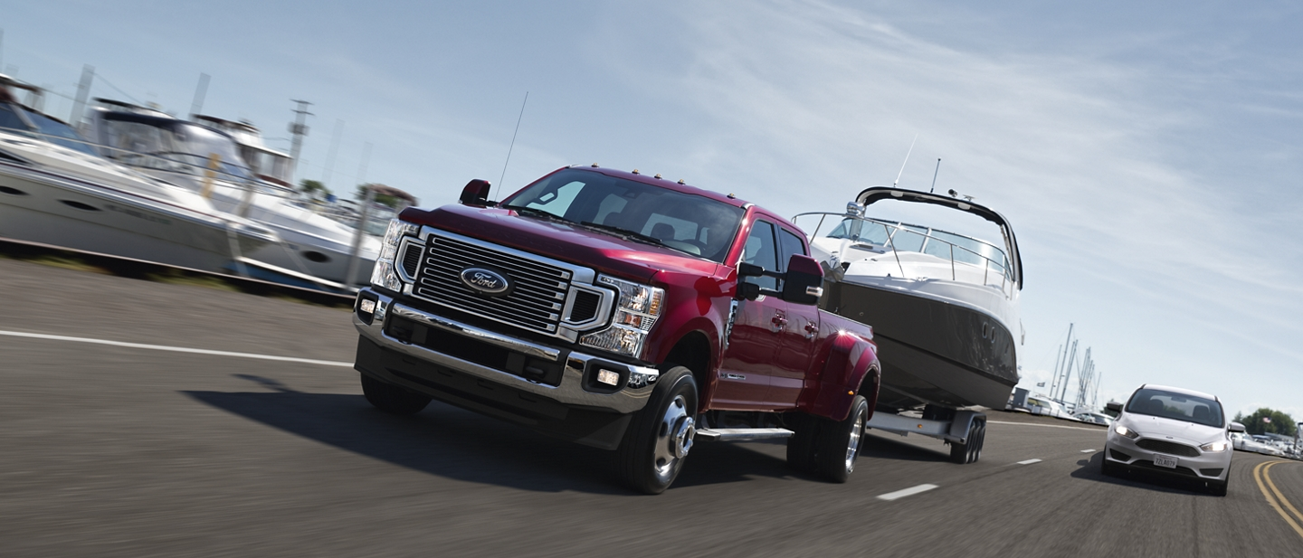 2020 Ford Super Duty on an expressway towing a boat