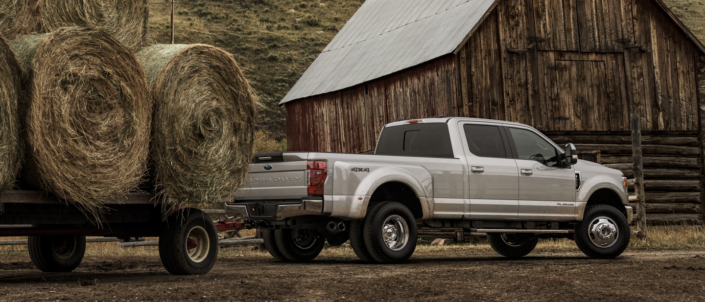 2020 Ford Super Duty towing bales of hay at farm