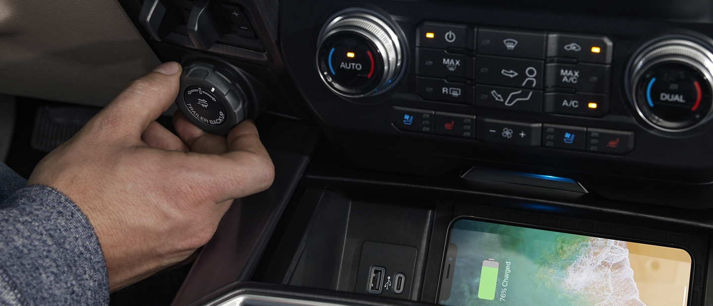 Driver hand engaging the pro trailer assist in the cab of a 2020 Super Duty