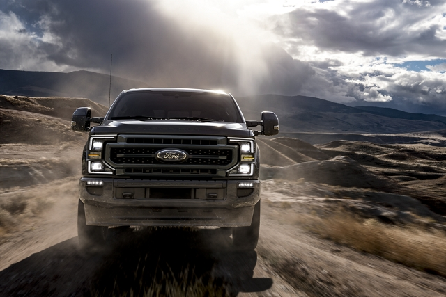 Front view of 2020 Ford Super Duty driving on dirt road