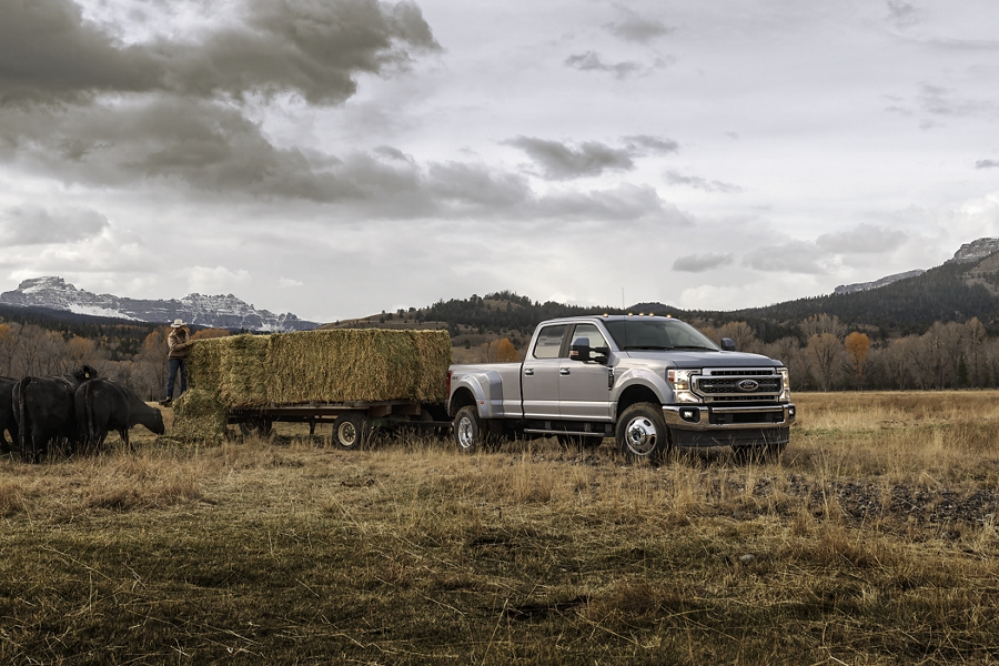 2020 Ford Super Duty towing large barrels of hay
