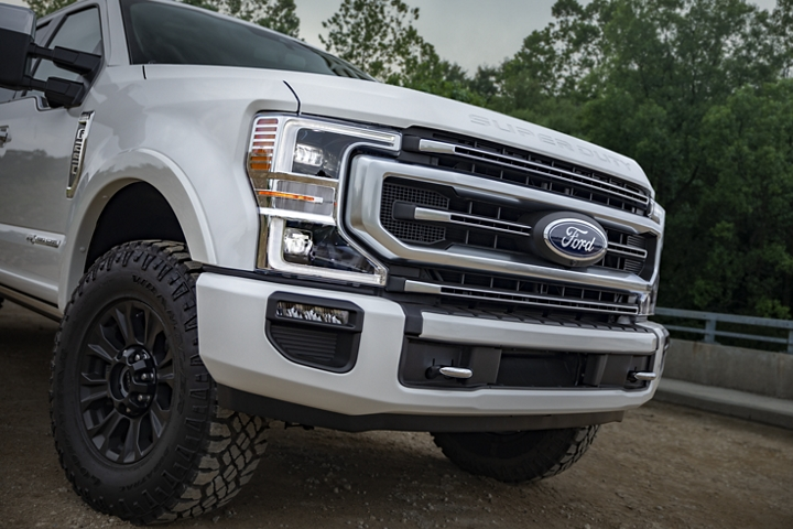 2020 Ford Super Duty F 2 50 Platinum Crew Cab with Tremor Off Road Package in Star White Metallic with close up on satin chrome grille