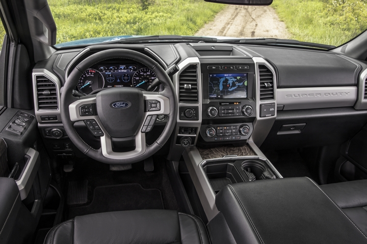 2020 Ford Super Duty Lariat with Tremor Off Road Package and Ebony Leather Interior being driven on unpaved road