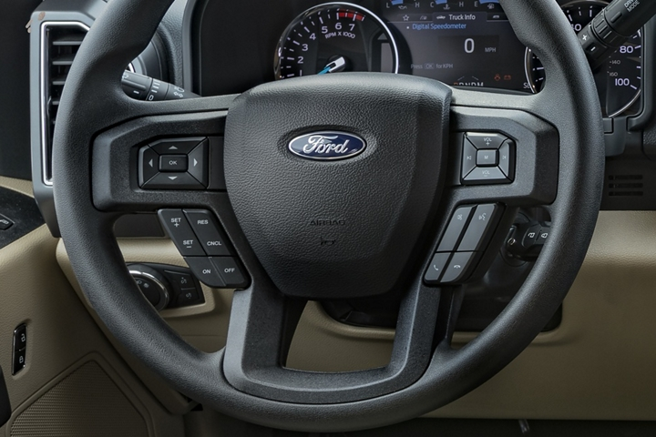 2020 Ford Super Duty steering wheel showing audio control buttons on steering wheel