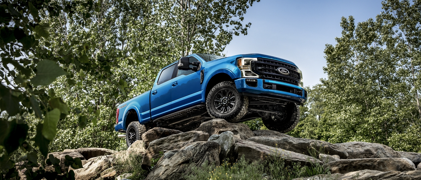 2020 Ford Super Duty with Tremor Off Road Package being driven down a hill of large boulders
