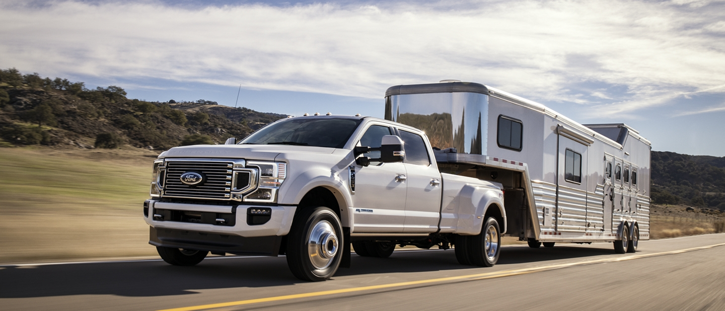 2020 Ford Super Duty towing trailer on road