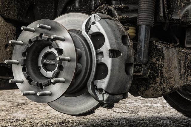 2020 Ford Super Duty with wheel removed showing its brake calipers and rotors