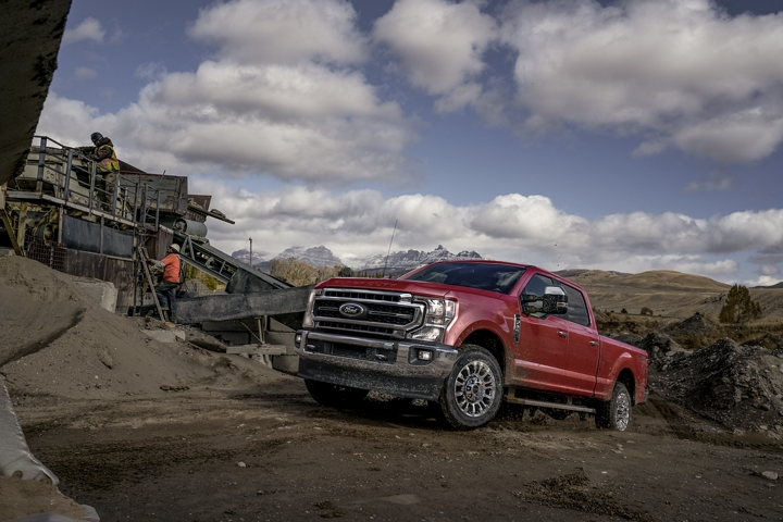 2020 Ford Super Duty F 2 50 LARIAT with Chrome Package in Rapid Red at a construction site