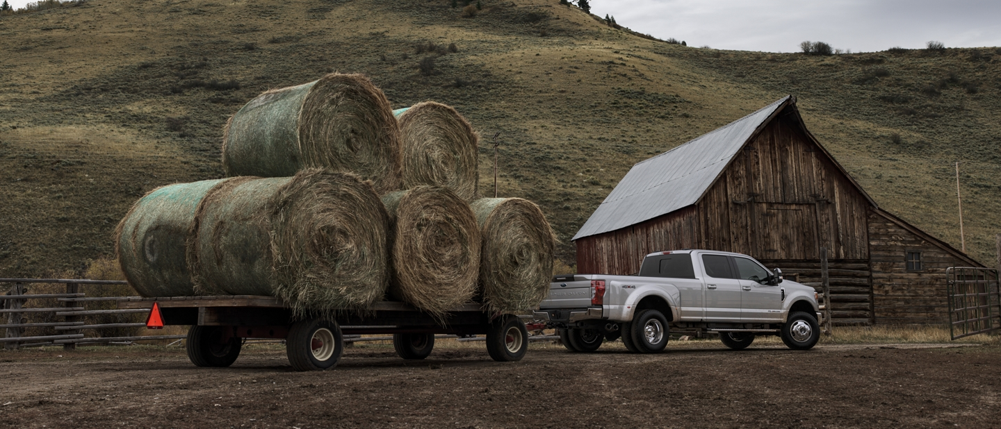 2020 Ford Super Duty with conventional hitch towing hay