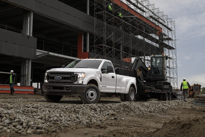 2020 Ford Super Duty F 3 50 X L D R W Regular Cab in Oxford White towing a backhoe