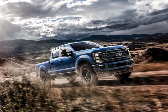 2020 Ford Super Duty being driven on a hilly road