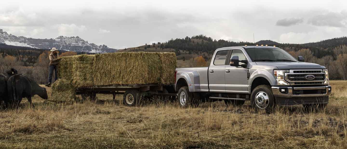2020 Ford Super Duty with fifth wheel hitch towing hay