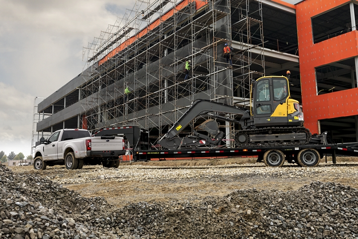 2020 Ford Super Duty X L F 3 50 D R W Regular Cab in Oxford White towing a backhoe at construction site